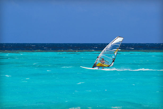 Windsurfing at Maafushivaru Island Resort in the Maldives
