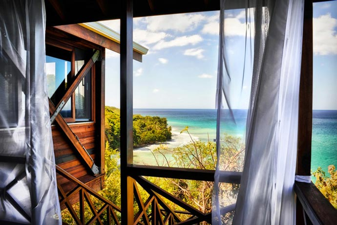 View of the ocean from a bungalow at Secret Bay Resort