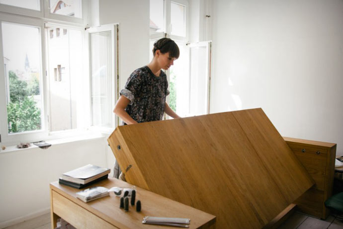 Desk that is being transformed into a bed
