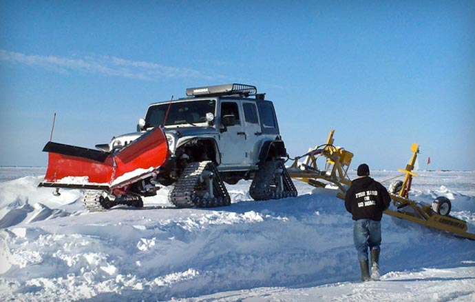 Dominator Tracks snow removal jeep