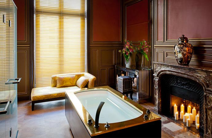 Room with bath and fireplace at buddha bar