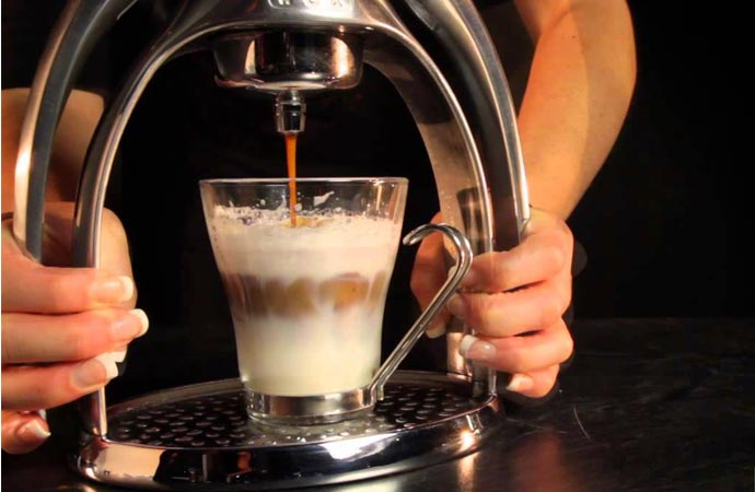 Making espresso with a hand pressed espresso maker