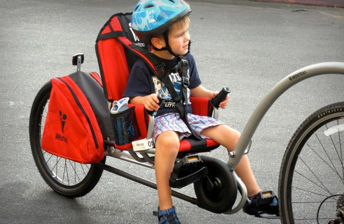 Child on a bicycle trailer
