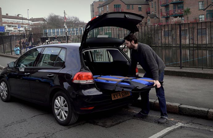 Foldable rowboat stored in a car