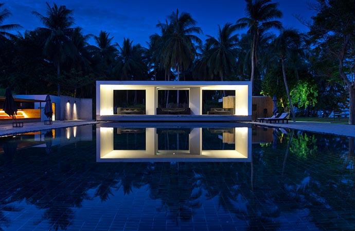 Swimming pool at night at X2 Samui