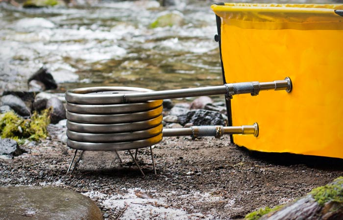 Nomad collapsible hot tub heated by propane firewood or coal