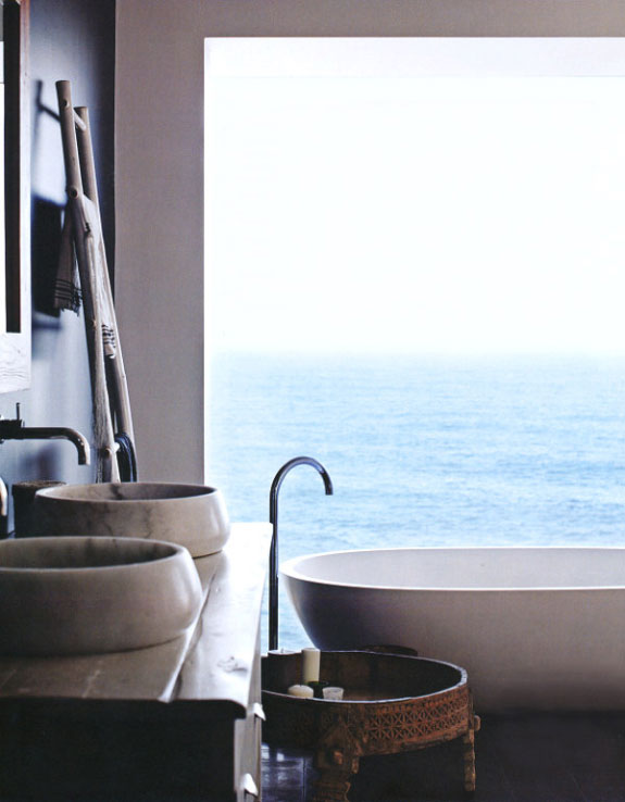Open bathroom with a seaside view