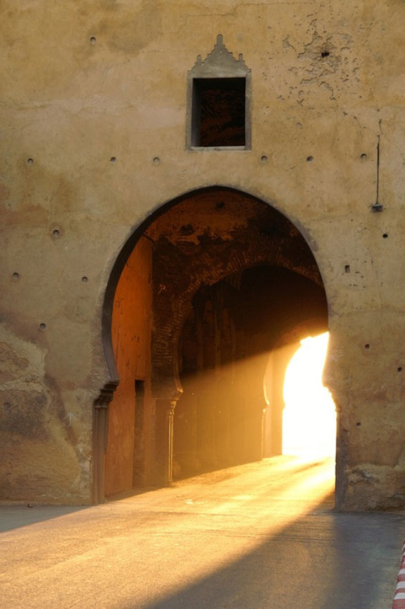 Arabic city doors with sunlight going through them