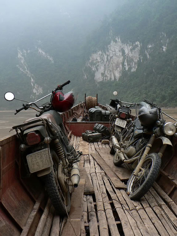 Motorbikes being transported on a boat