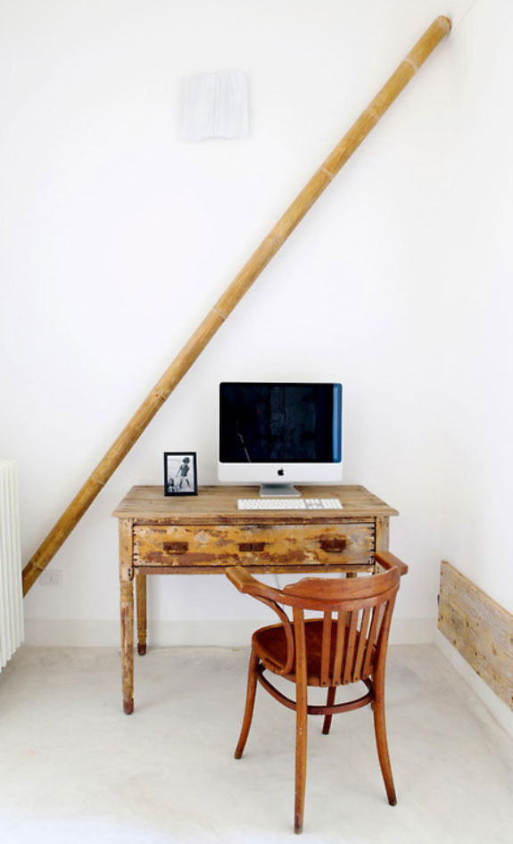 Rustic working table with Mac computer on it