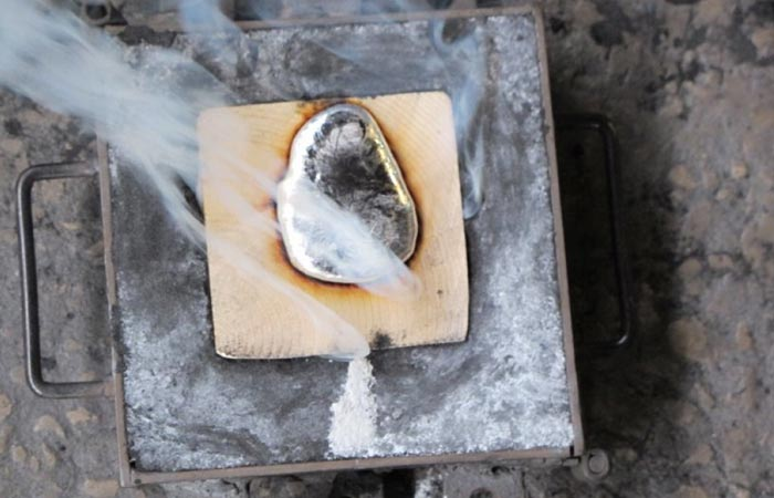 Wood Casting furniture with molten aluminum poured in the cracks of wood pieces