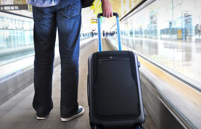 Man using the Bluesmart carry-on bag