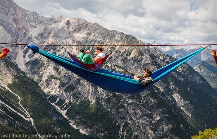 People in hammocks at the Slackline Festival in the Alps