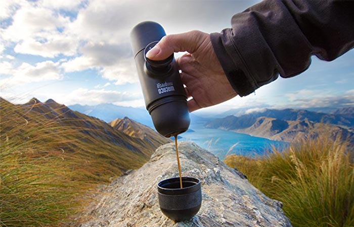Puring coffee from WACACO Minipresso Espresso Maker