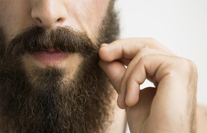 A guy with the beard holding his moustaches