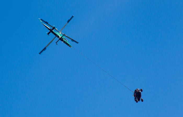 Polaris being towed by a helicopter