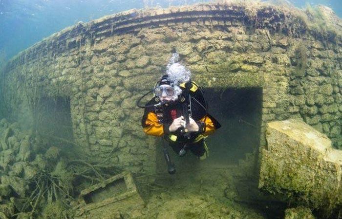 Scuba diver underwater at a prison in Estonia