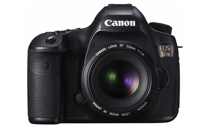 Canon EOS 5DS digital SLR with lens