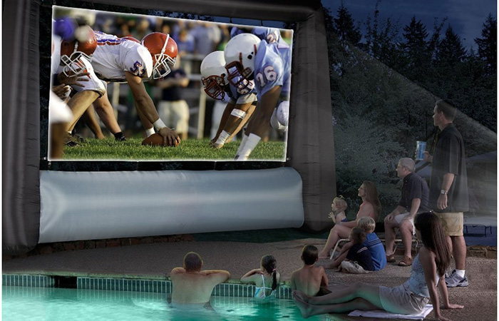 People watching football via inflatable screen