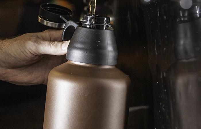 Mira beer growler being filled up