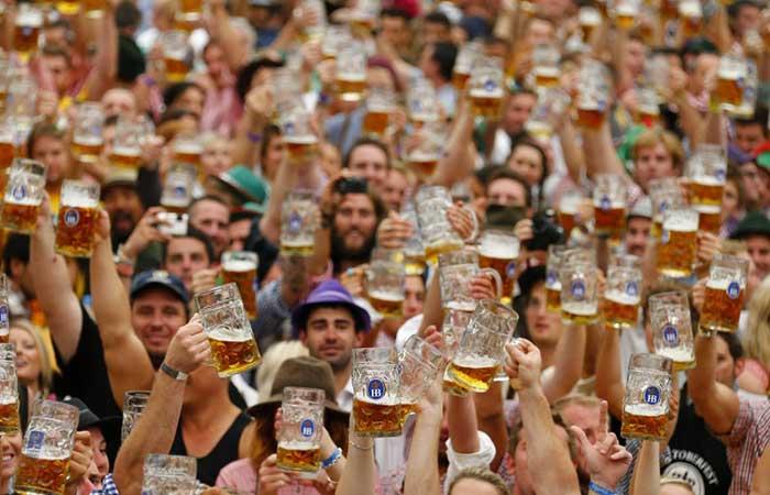 People holding kegs of beer