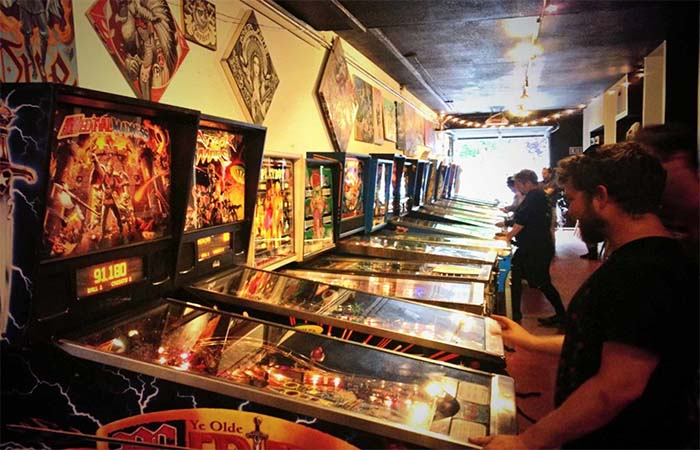 Free Gold Watch Arcade people playing games on pinnball machines