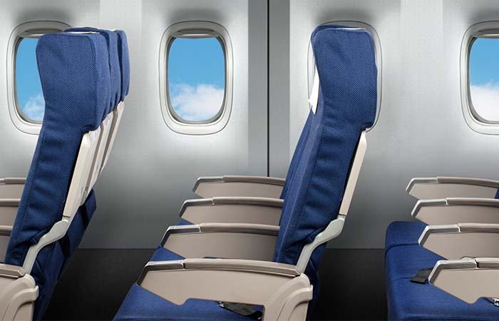 Blue And White Seats In The Airplane
