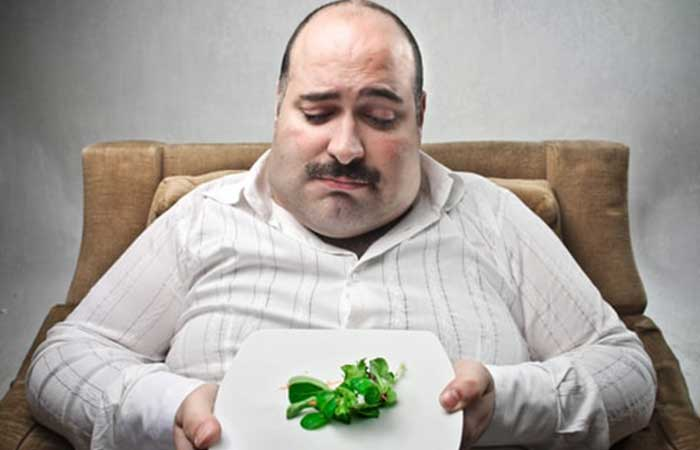 Sad man eating vegan food