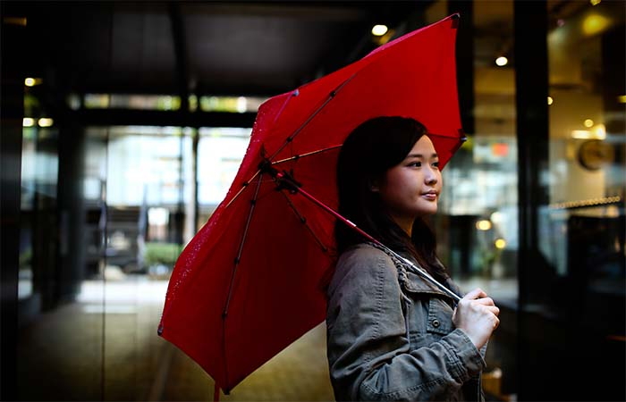 A girl holding red Cypress Umbrella