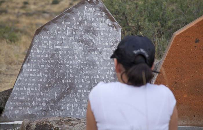 A girl reading Crystals of Refrain Stone in Armenia