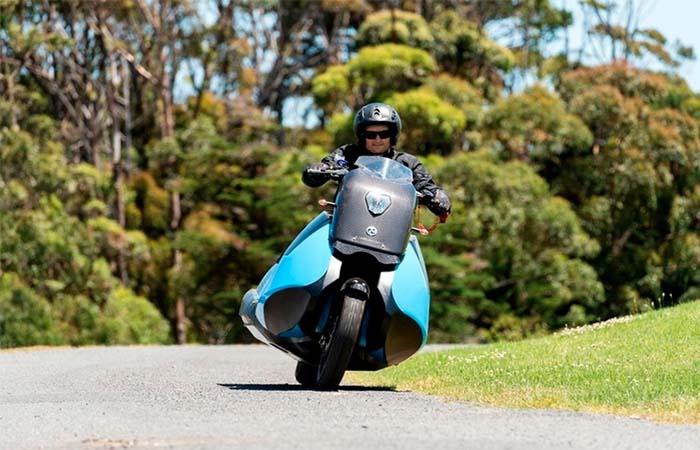 A guy riding Gibbs Biski Motocycle