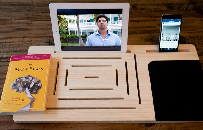 Tablet and smartphone on a bamboo table