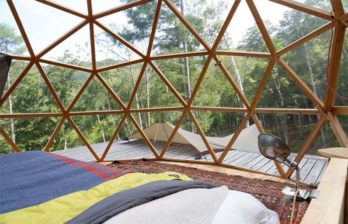 Glass dome bedroom of a mountain cottage in Japan