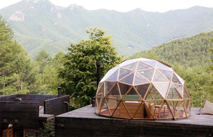 A glass dome bedroom of a mountain cottage in Ogawayama Japan