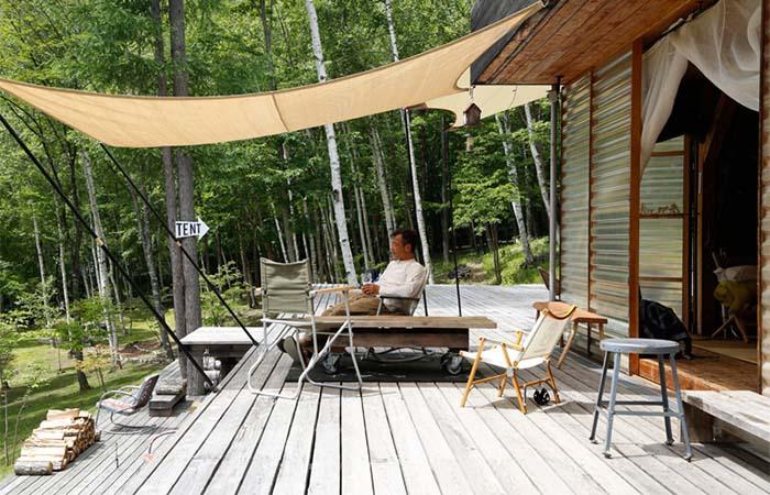 Setsumasa Kobayashi Sitting On The Porch In His Cottage