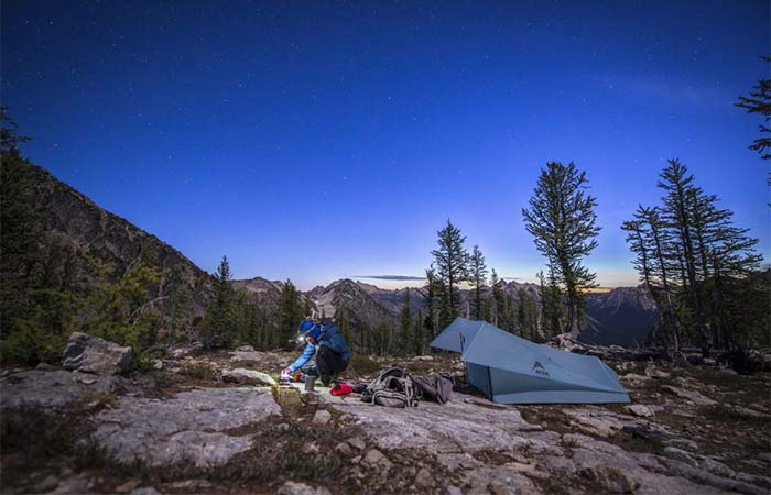 A guy camping in MSR Flylite 2-Person Trekking Pole Tent