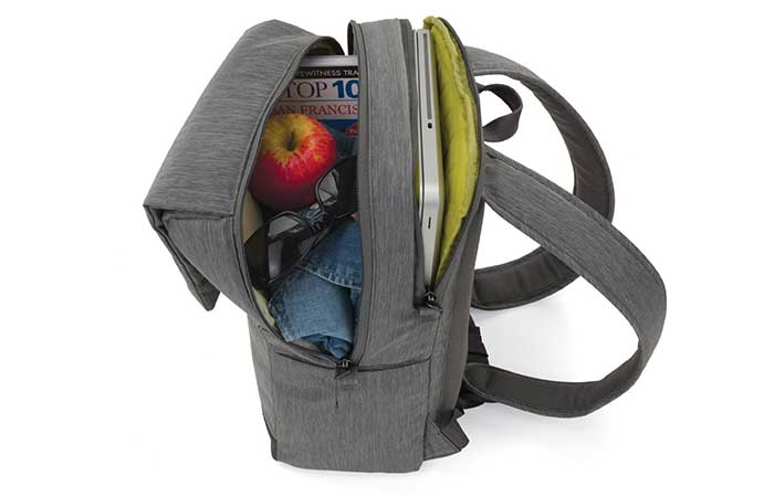 Open Notebook Montgomery Street Backpack with an apple, a laptop and sunglasses inside