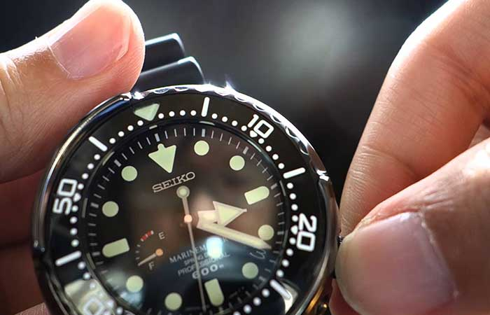 A man setting the time on SBDB009 – Seiko Prospex MarineMaster Spring Drive Diver's Watch