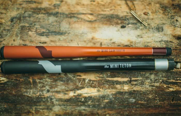Tenkara Mini Sawtooth and Mini Teton Fishing Rods placed on a wooden table