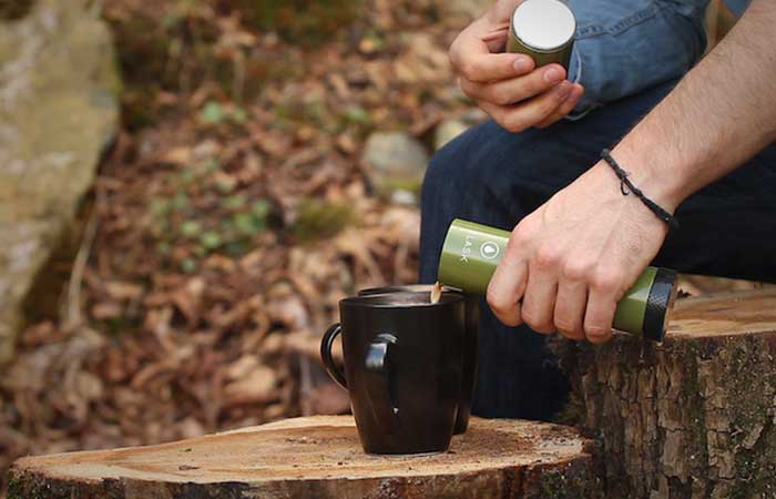 A man pouring coffee from VSSL Flask Light