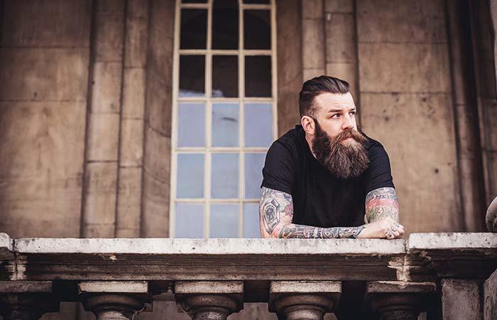 A guy with beard on the balcony
