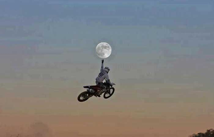 Motorcyclist catching the moon