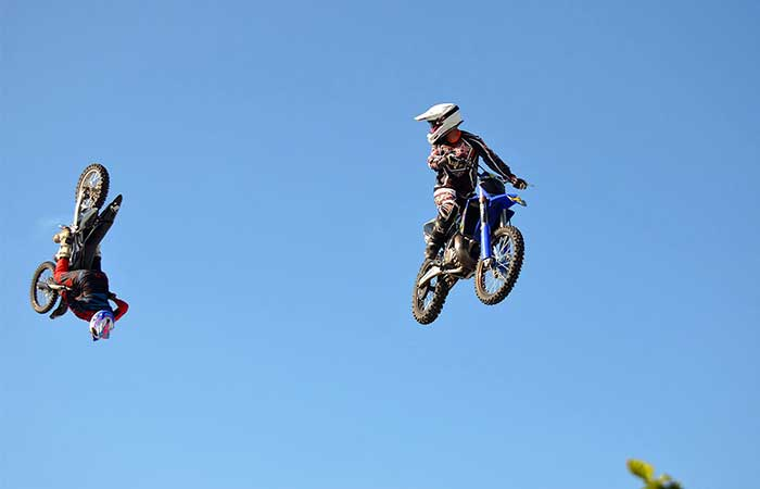 Two motorcyclists in the air