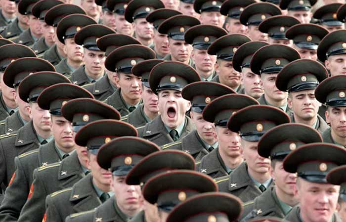Many soldiers, one yawning