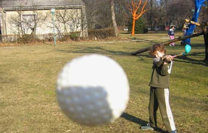 Golf ball flying into camera