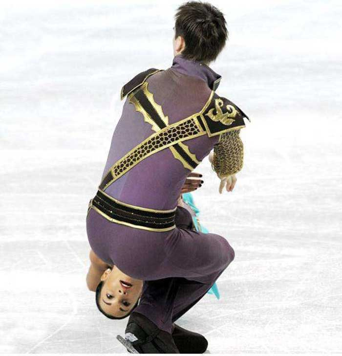 A weird position of ice skating couple