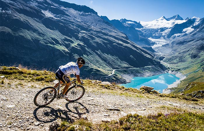 Mountain cycling next to a lake