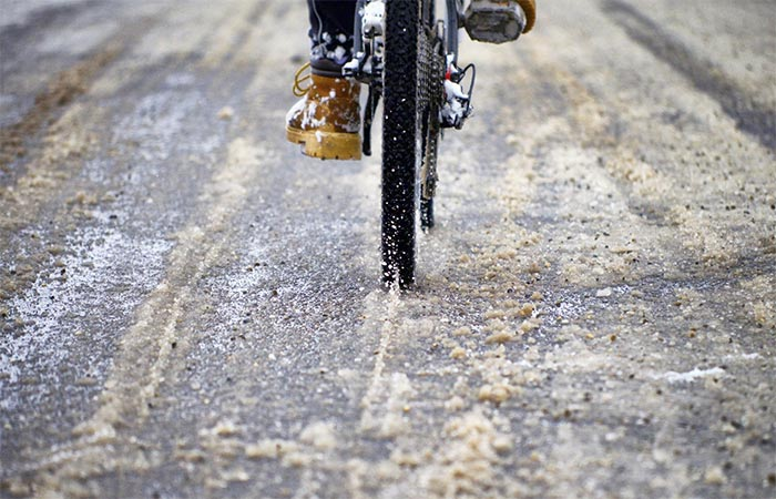 Riding A Bike On The Road In Winter