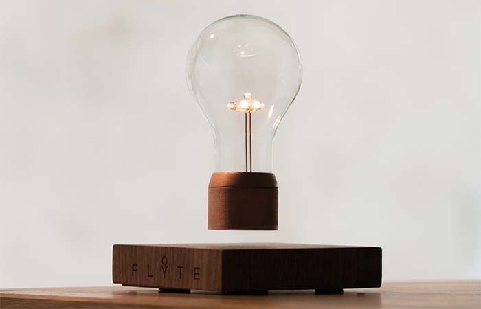 Flyte Light Bulb Levitating Over Wooden Base