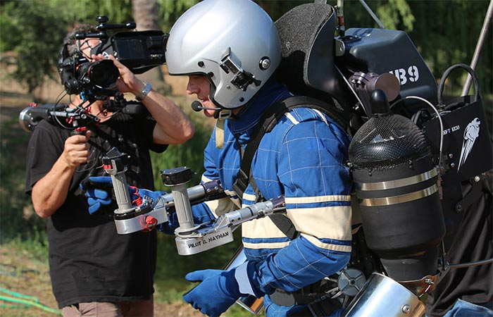 A guy preparing to start a ride on JB-9 Personal Jetpack